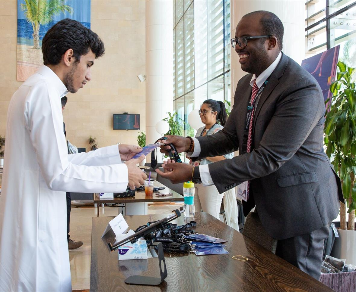 KGSP Student Advisor Stafford Oliver welcomes a new Cohort 11 student to the KAUST campus