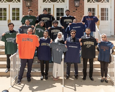 University of Illinois at Urbana-Champaign KGSP Foundation Year students proudly displaying shirts of their undergraduate school.