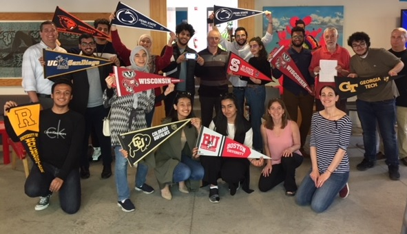 University of Pennsylvania KGSP Foundation Year students with pennants of their undergraduate school.